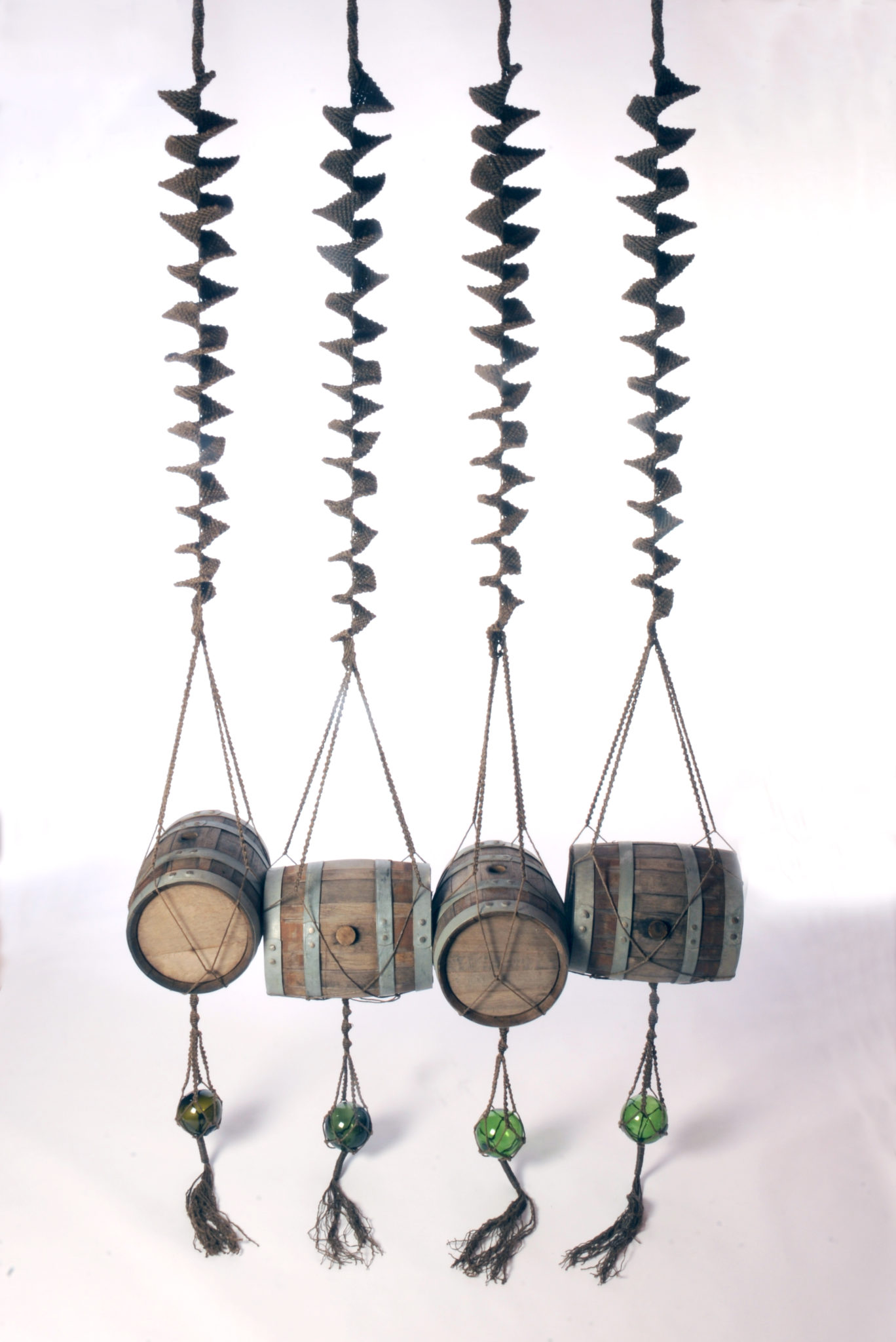 To the Four Corners of the Earth - 360 x 130 x 43 - 200 metres of hand knotted tarred marlin rope, four oak pin barrels - 2013